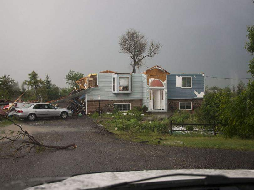 tornado damaged home Abbotts Fire and Flood Colorado