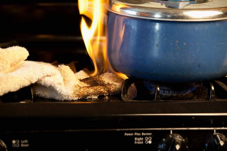 Dish towel catching on fire from stove top